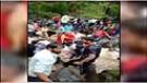ગિરનાર પર ચઢેલા 50 શ્રદ્ધાળુઓ અધવચ્ચેથી વહેતા પાણીમાં ફસાયા, સ્થાનિકોએ દોરડા નાંખી બચાવ્યા